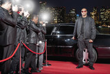 Bodyguard opening limo door on red carpet