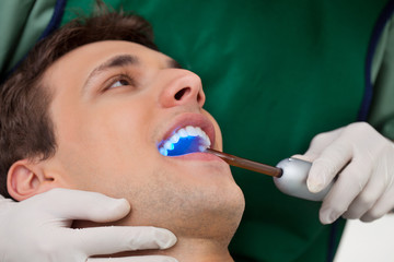 Dentist with UV Light