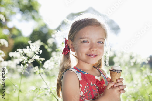 Girl eating ice cream outdoors