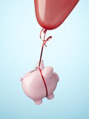 Piggy bank tied to balloon