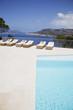 Lounge chairs beside pool