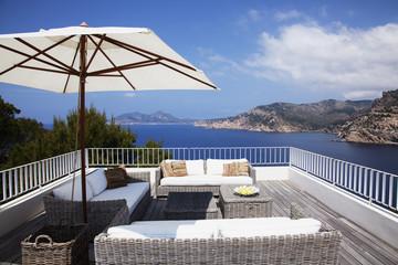 Sofas on patio overlooking skyline