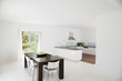 Table and chairs in modern kitchen