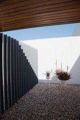 Metal gate in modern courtyard