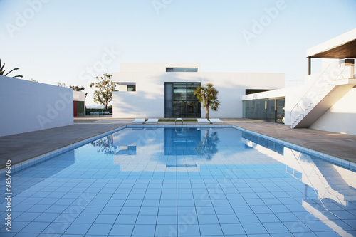 Pool outside modern house