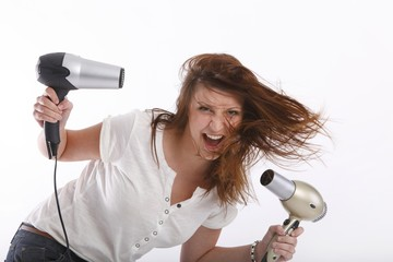 wild young woman with two hairdryer