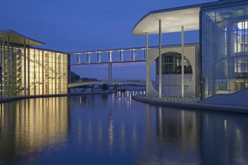 Skybridge between modern buildings on water