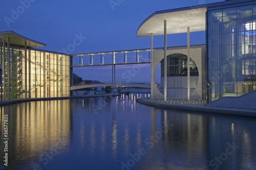 Skybridge between modern buildings on water