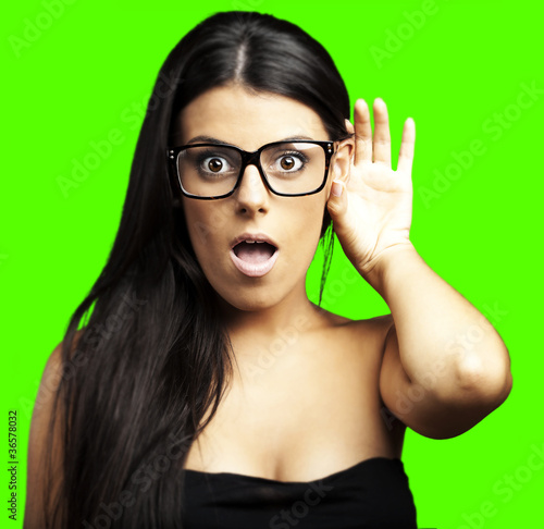 woman earing a sound over removable chroma key background