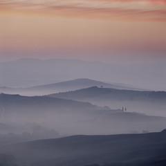 Foggy hills in rural landscape