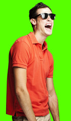 young man laughing over removable chroma key background