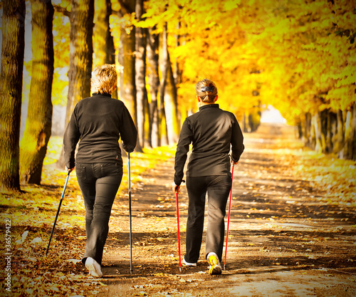 Two women in the park - Nordic walking