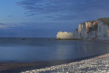 Sheer white cliffs on beach