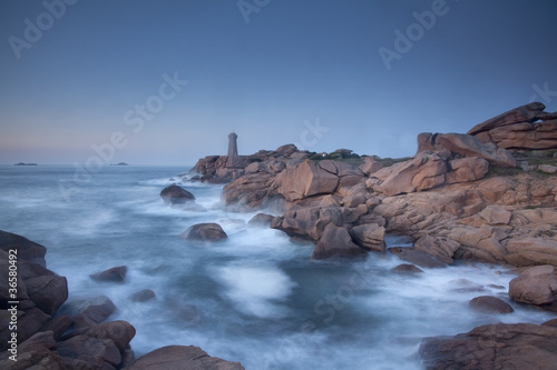 Lighthouse on rocky coastline