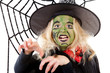 Scary green witch for Halloween with spiderweb