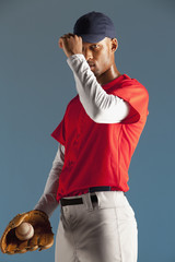 Baseball player holding ball in glove