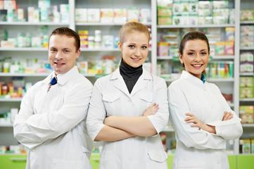 Pharmacy chemist team women and man in drugstore