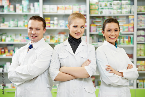 Pharmacy chemist team women and man in drugstore