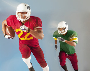 Football players running with ball