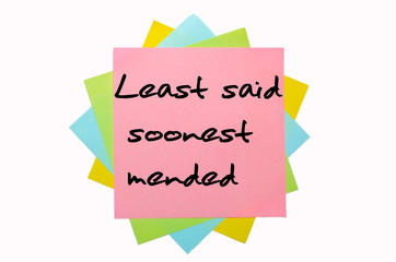 "Proverb ""Least said soonest mended"" written on bunch of sticky n"