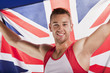 Athlete holding Union Jack flag