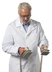 Doctor using a defibrillator