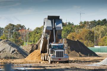 Dump truck dumbing dirt