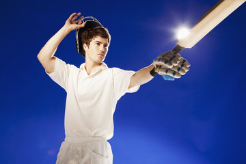 Cricket player pointing with bat
