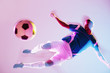 Blurred view of soccer player kicking ball