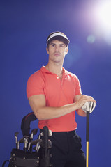 Golf player with club and golf bag