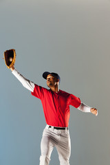 Baseball player catching ball in glove