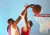 Blurred view of basketball player dunking