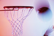 Blurred view of basketball going into hoop