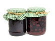 plum jam and preserved cherries in glass jar
