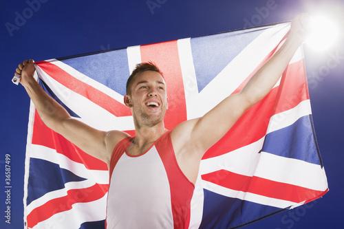 Athlete carrying Union Jack flag