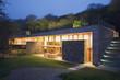 Modern house lit up at twilight