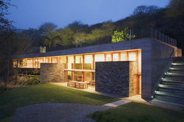 Modern house lit up at twilight
