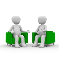two guys sitting on a couch. talking