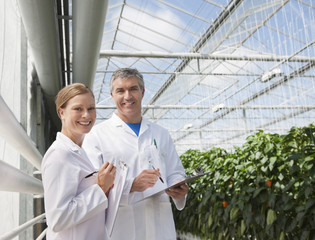 Scientists talking in greenhouse