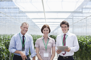 Workers standing together in greenhouse