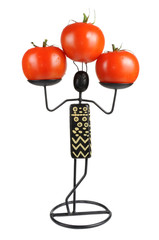 Figurine with Tomatoes Isolated on White Background