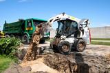 Mini excavator at construction site - 36591613