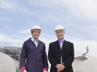 Businessman and worker standing together outdoors