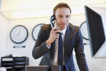 Businessman talking on phone at desk
