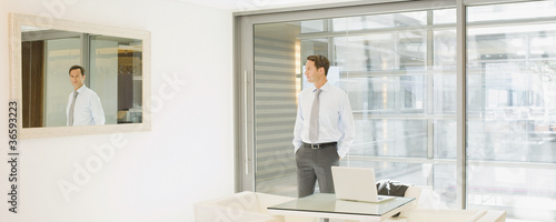 Businessman standing in empty office