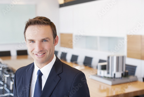 Businessman smiling in conference room