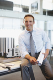 Businessman with architectural model in office