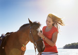 Girl petting horse outdoors