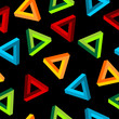 Abstract shape pattern with four colors over black