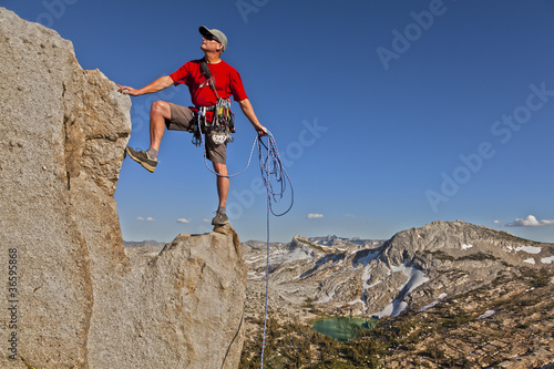 Rock climber celebrates on the summit.